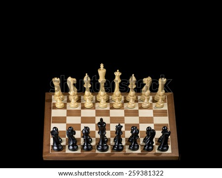 Chess game - white and black pawns, figures on the chess board - stock photo
