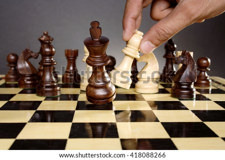 Chess king is checkmated - Chess game over - stock photo