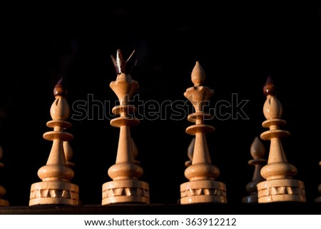 Chess king queen bishop knight and chessboard.