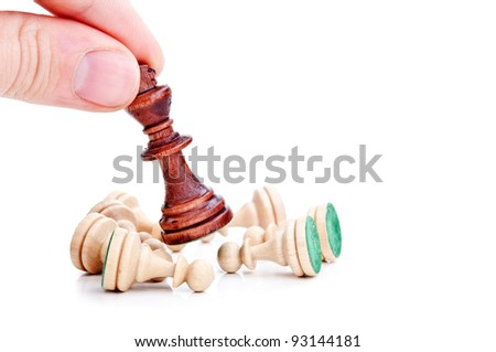 chess king surrounded by pawns isolated on a white background - stock photo