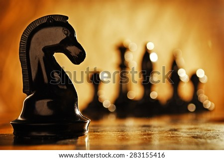 Chess knight chess pieces in front and in the background. The idea of winning and strategies. - stock photo