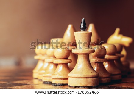 Chess leader led his army white wooden figures. Concept game - stock photo