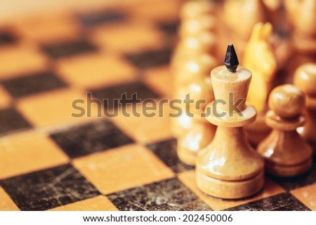 Chess leader led king his army white wooden figures. Concept game background. Close up focus - stock photo