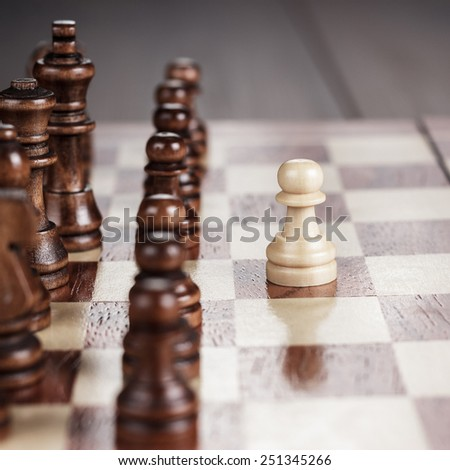 chess leadership concept on the wooden chessboard - stock photo