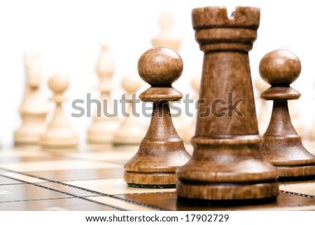 chess on white (focus on pawns) - stock photo