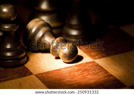 Chess pawn defeated - stock photo