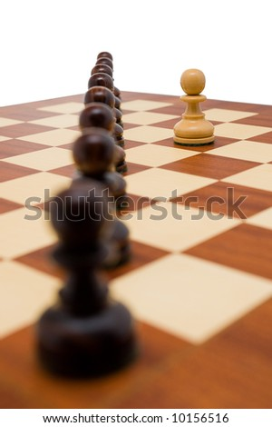 Chess pieces - a single white pawn standing in front a row of black pawns.