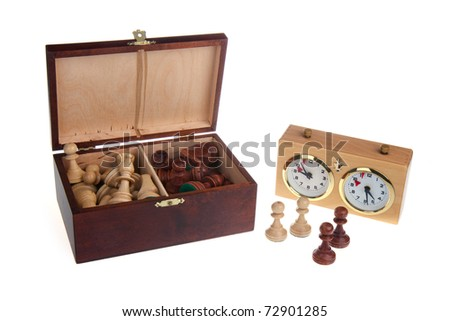 Chess pieces and a chess clock - stock photo