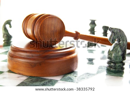 chess pieces and law gavel, over white - stock photo