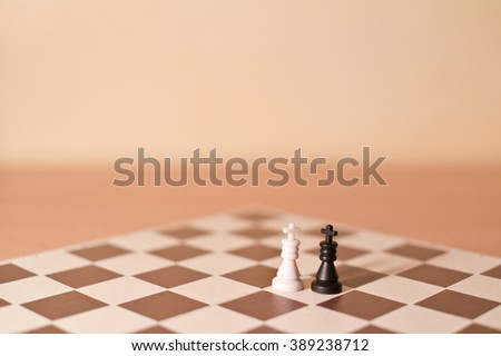 Chess pieces as metaphor - two kings as homosexual couple of two gays. Creamy tint and shallow focus  - stock photo