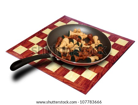 chess pieces in a skillet