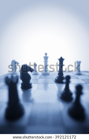 Chess pieces in vertical with room for type - stock photo