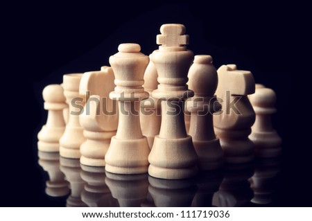 chess pieces on a black background - stock photo