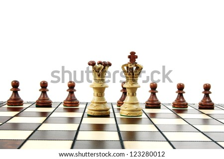 chess pieces on a chess board showing concept for strategic business - stock photo