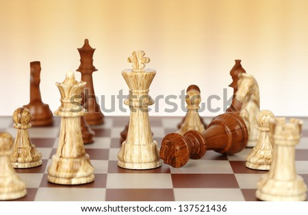 chess pieces on chessboard - stock photo