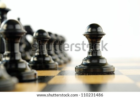 chess pieces on the board during the game - stock photo