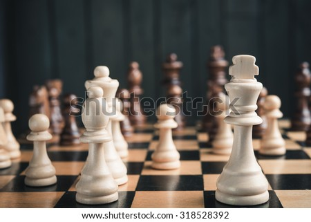 chess pieces on  wood background - stock photo