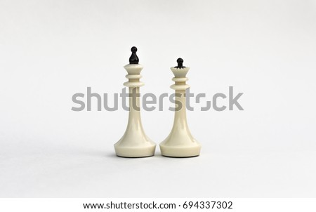 Chess pieces. The white king and Queen on white background