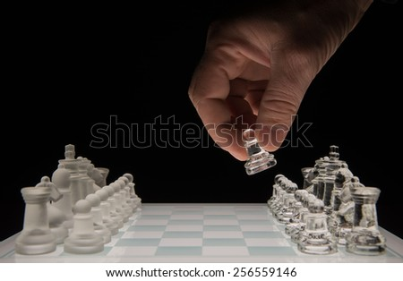 Chess player makes the first  move - stock photo