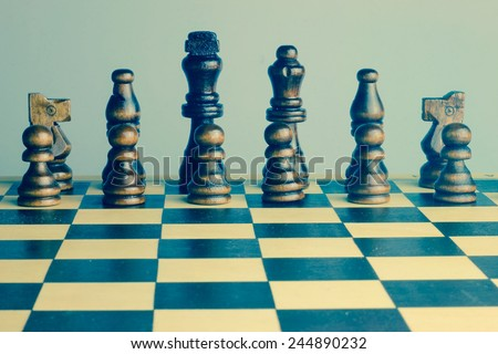 Chess set retro photo with chess board and chess pieces. - stock photo