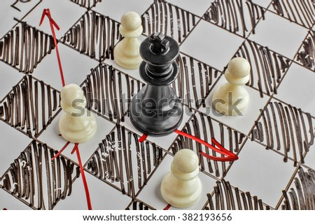 Chess. The black King is under attack. White board with chess figures on it. Helpmate or checkmate. - stock photo