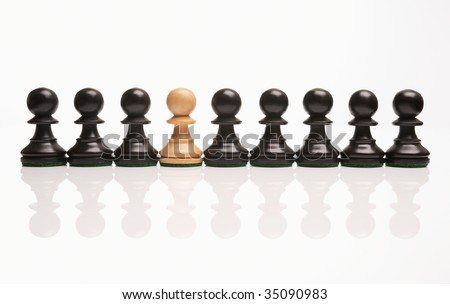 chess the odd one out white pawn in row of black pawns - stock photo
