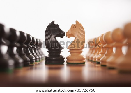 chess two rows of pawns with knight challenge center selective focus - stock photo