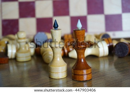 Chessboard and game of chess. The queen, rook, pawn, knight. - stock photo