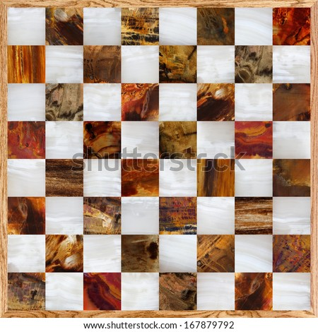 Chessboard made of onyx and petrified wood with an oak frame - stock photo