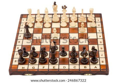 Chessboard on which just started a chess battle isolated on a white background - stock photo