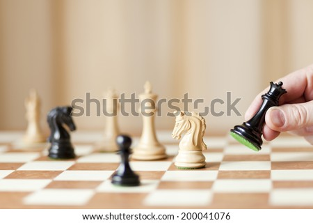 chessboard with luxury chess pieces, queen capturing knight