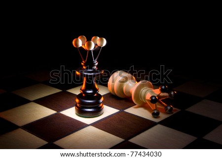 Chessmen (black and white a queen). A dark art background. - stock photo