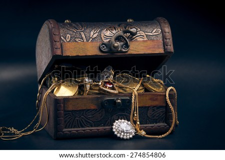 chest full of money, treasure chest with gold coins - stock photo