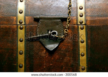 Chest locked with a pin - stock photo