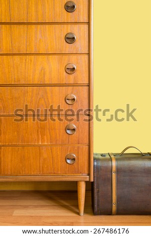 Chest of drawers and Vintage suitcase - stock photo