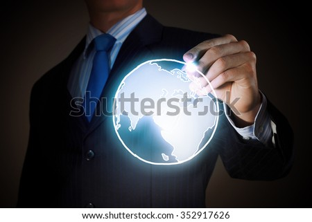Chest view of businessman drawing digital planet on screen