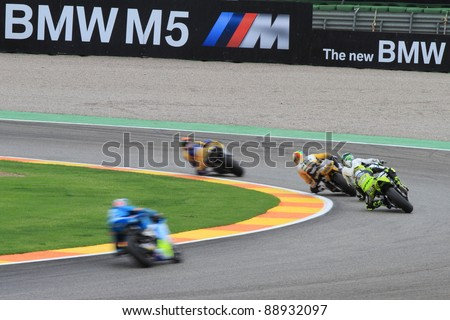 CHESTE - NOVEMBER 6: several riders of moto2 in a curve participating in the final race of Grand Prix 2011 on November 6, 2011 in Cheste (Valencia), Spain