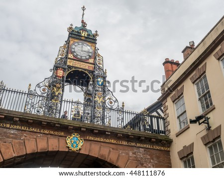 CHESTER - MAY 20 : Eastgate clock tower on bridge in Chester city, England, under cloudy sky, on May 20, 2016.