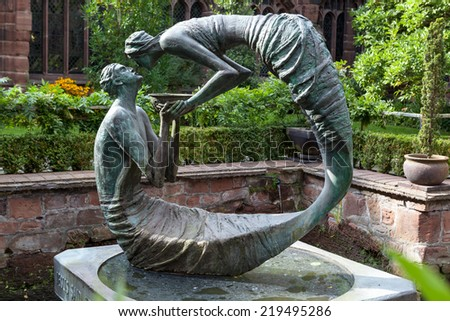 "CHESTER, UK - SEPTEMBER 15, 2014:The sculpture ""The water of life"" by Stephen Broadbent in a Chester Cathedral.The sculpture presents the life changing encounter between Jesus and the woman of Samaria - stock photo"