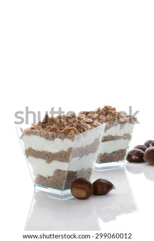 Chestnut puree dessert and chestnuts isolated on white background. Culinary sweet dessert eating.  - stock photo