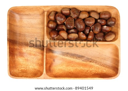 chestnuts in a wooden bowl, isolated, white background - stock photo