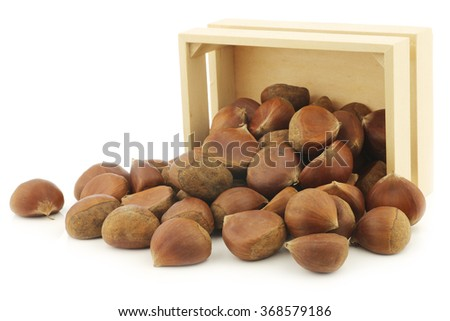 chestnuts in a wooden box on a white background - stock photo