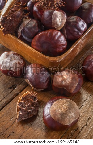 chestnuts on a wooden table - stock photo