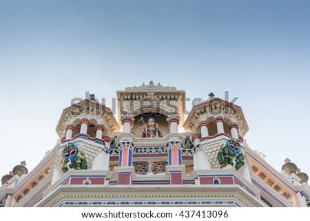 Chettinad, India - October 17, 2013: Chidambara Palace in Kadiapatti. Meenakshi statue on top of facade flanked by two green monsters. Niche and towers. - stock photo