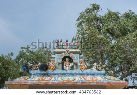 Chettinad, India - October 17, 2013: Kothamangalam Ayyanar horse shrine. On top of small shrine, sits Shiva and his two sons, Ganesha and Murugan. Ayyanar figures on the corners with nandi the bull. - stock photo