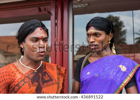 Chettinad, India - October 17, 2013: Ms. Abinaja and Ms. Sheila, both Hijras, transgender persons. Hijras are males who dresses and acts like women, Dark, open faces, saris and jewelry. Karaikudi city - stock photo