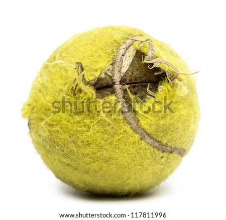 Chewed tennis ball against white background - stock photo