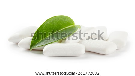 chewing gum with green leaf isolated on a white background - stock photo