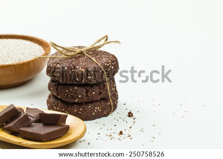 Chia seed chocolate cookie stack with ingredients on white - stock photo