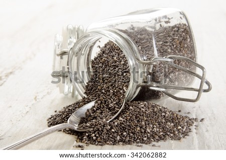 chia seed in a glass container and spoon - stock photo